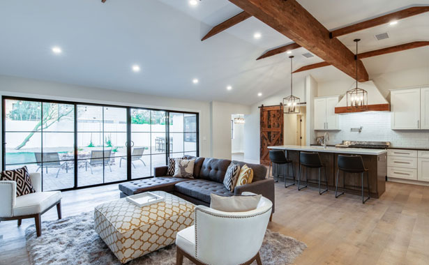 remodeling open concept living room and kitchen with exposed rafters